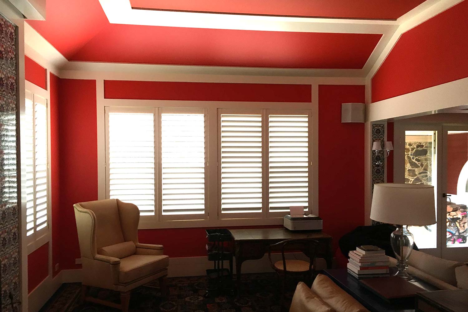 Red walls with striking white woodwork
